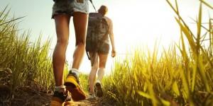 hiking-backpack-through-grass-friends